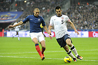 FOOTBALL - INTERNATIONAL FRIENDLY GAMES 2011/2012 - FRANCE v USA - 11/11/2011 - PHOTO JEAN MARIE HERVIO / DPPI - CARLOS BOCANEGRA (USA) / KARIM BENZEMA (FRA)