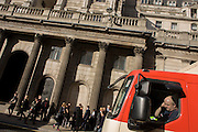 Truck passenger and incidental people outside the Bank of England in the City of London, England UK.