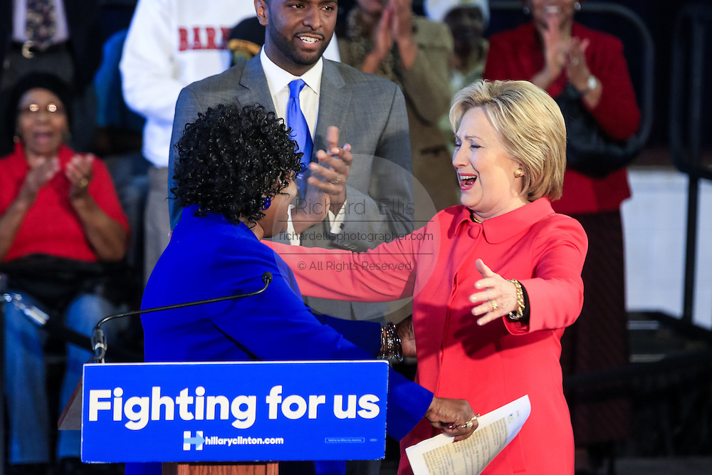 """Democratic presidential candidate Hillary Rodham Clinton embraces Bamberg County Schools Superintendent Thelma Sojourner during a """"Corridor of Opportunity"""" Town Hall meeting at Denmark-Olar Elementary School February 12, 2016 in Denmark, South Carolina, USA. The event highlighted the disparities facing poor black families and rural poor in South Carolina."""