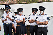 Young students dressed in Calavera Catrina police costume s during the Day of the Dead or Día de Muertos festival October 31, 2017 in Patzcuaro, Michoacan, Mexico. The festival has been celebrated since the Aztec empire celebrates ancestors and deceased loved ones.