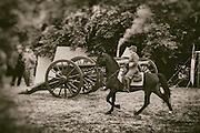 USA, Oregon, Brooks, Willamette Mission State Park, Confederate cavalry rides through the Confederate artillery reenactor camp.