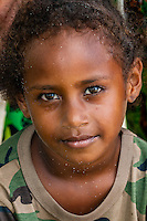 Kanak (Melanesian) girl on the beach at Mebuet, island of Mare, Loyalty Islands, New Caledonia