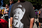 "A t-shirt showing the laughing face of Carry On Films comedian and actor Sid James. He was known for his trademark ""dirty laugh"" and lascivious persona. London, UK."