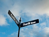 Pacific Ave and Forth Street signs against the sky in downtown Bremerton, WA, USA