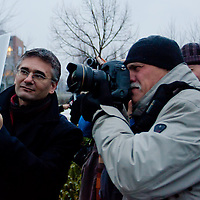 Photographer takes photo of a viewer photographing with an iPad after the inauguration ceremony of the first ever life-size bronze statue of late Apple leader Steve Jobs in Budapest, Hungary on December 21, 2011. ATTILA VOLGYI