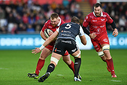 Samson Lee of Scarlets is tackled by Alun Wyn Jones of Ospreys<br /> <br /> Photographer Craig Thomas/Replay Images<br /> <br /> Guinness PRO14 Round 11 - Ospreys v Scarlets - Saturday 22nd December 2018 - Liberty Stadium - Swansea<br /> <br /> World Copyright © Replay Images . All rights reserved. info@replayimages.co.uk - http://replayimages.co.uk