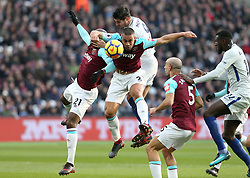 9 December 2017 - Premier League Football - West Ham United v Chelsea -  Winston Reid of West Ham looks after the ball as it is headed out of play - Photo: Charlotte Wilson / Offside