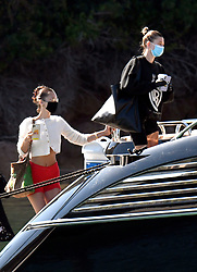 Hailey Bieber and Bella Hadid arrives at Olbia Airport on a private jet before boarding a yacht together. 23 Jun 2020 Pictured: Hailey Bieber and Bella Hadid. Photo credit: MEGA TheMegaAgency.com +1 888 505 6342