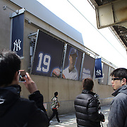 Japanese media filming the Tanaka poster outside Yankee Stadium before the New York Yankees V Chicago Cubs, double header game one at Yankee Stadium, The Bronx, New York. 16th April 2014. Photo Tim Clayton