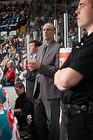 KELOWNA, CANADA - MARCH 23: Ryan Huska, head coach of the Kelowna Rockets stands on the bench against the Tri-City Americans on March 23, 2014 during game 2 of the first round of WHL Playoffs at Prospera Place in Kelowna, British Columbia, Canada.   (Photo by Marissa Baecker/Getty Images)  *** Local Caption *** Ryan Huska;
