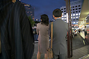 businesspeople waiting for taxi Tokyo Shinagawa station