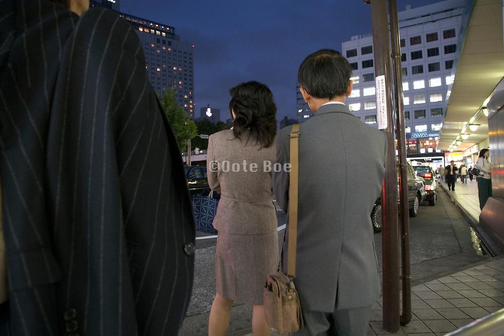 businesspeople waiting for taxi Tokyo Shinagawa station