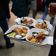 RALEIGH, NC - FEBRUARY 23: An employee from Locals Oyster Bar, one of a handful of businesses housed inside Transfer Co. Food Hall, delivers a plate of fried fish to come customers on February 23, 2019 in Raleigh, NC. (Logan Cyrus for The New York Times)