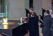U.S Under Secretary of State Stuart Eizenstat lights a candle before the opening ceremony for the Conference on Holocaust-Era Assets at the US Holocaust Museum November 30, 1998 in Washington, DC. Standing behind Eizenstat is Nobel Peace Laureate Elie Wiesel.