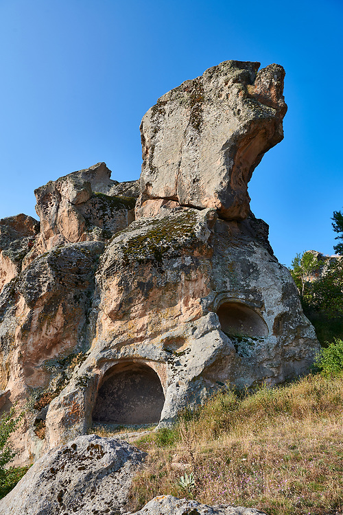 Phrygian tombs cut into rock formations  protecting the citadel of Midas . From the 8th century BC . Midas City, Yazilikaya, Eskisehir, Turkey.<br /> <br /> The earliest Phrygian settlement here began in the last quarter of the 8th century BC. Even after the Phrygian kingdom collapsed politically, the city was not abandoned and the Phrygian rock structures and tombs were conserved, with some additions and changes made.in the Persian, Hellenistic, Roman and Byzantine periods. .<br /> <br /> If you prefer to buy from our ALAMY PHOTO LIBRARY  Collection visit : https://www.alamy.com/portfolio/paul-williams-funkystock/ancient-midas-turkey.html<br /> <br /> Visit our CLASSICAL WORLD HISTORIC SITES PHOTO COLLECTIONS for more photos to download or buy as wall art prints https://funkystock.photoshelter.com/gallery-collection/Classical-Era-Historic-Sites-Archaeological-Sites-Pictures-Images/C0000g4bSGiDL9rw