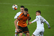 Rafa Mir of Wolverhampton Wanderers © gets the ball ahead of Tom Carroll of Swansea city ® . The Emirates FA Cup, 3rd round replay match, Swansea city v Wolverhampton Wanderers at the Liberty Stadium in Swansea, South Wales on Wednesday 17th January 2018.<br /> pic by  Andrew Orchard, Andrew Orchard sports photography.