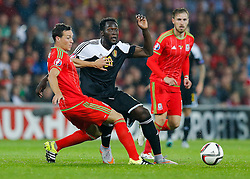 Romelu Lukaku of Belgium (Everton) is challenged by James Chester of Wales (Hull City) - Photo mandatory by-line: Rogan Thomson/JMP - 07966 386802 - 12/06/2015 - SPORT - FOOTBALL - Cardiff, Wales - Cardiff City Stadium - Wales v Belgium - EURO 2016 Qualifier.
