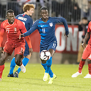 EAST HARTFORD, CONNECTICUT- October 16th:   Tim Weah #11 of the United States defended by Luis Advincula #17 of Peru during the United States Vs Peru International Friendly soccer match at Pratt & Whitney Stadium, Rentschler Field on October 16th 2018 in East Hartford, Connecticut. (Photo by Tim Clayton/Corbis via Getty Images)