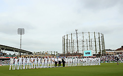 England's and Pakistan's players during a minutes silence during day one of the Fourth Investec Test match at The Kia Oval, London.