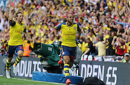 Arsenal's Theo Walcott opens the scoring during the The FA Cup match between Arsenal and Aston Villa at Wembley Stadium, London, England on 30 May 2015. Photo by Phil Duncan.
