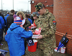 A young fan donates money to the poppy appeal outside Ibroxin the match between Rangers v Motherwell, Ladbrokes Scottish Premiership, Ibrox, Sunday 11 November 2018  (c) Angie Isac | SportPix.org.uk