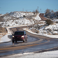 A vehicle is seen driving on Park Avenue Wednesday afternoon in Gallup. Park Avenue is a priority one snow route in Gallup.