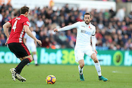 Gylfi Sigurdsson of Swansea city ® challenges Phil Jones  of Manchester Utd. Premier league match, Swansea city v Manchester Utd at the Liberty Stadium in Swansea, South Wales on Sunday 6th November 2016.<br /> pic by  Andrew Orchard, Andrew Orchard sports photography.