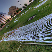 """""""Float"""" temporary art installation - Hammocks on the lawn at the Kansas City Convention Center across from the Kauffman Center for the Performing Arts"""