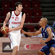 Turkey's izzet Turkyilmaz (L) and Finland's Shawn Huff during their Adidas Istanbul Cup 2012 Final basketball match Turkey between Finland at the Abdi ipekci Arena in Istanbul Turkey on Thursday 02 August 2012. Photo by TURKPIX