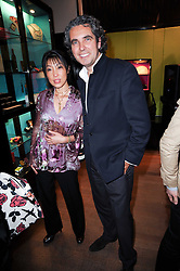 LI QUAN founder of Save China's Tigers and Shanghai Tang Executive Chairman, Raphael le Masne de Chermont at a private view of her work entitled 'Martha Fiennes' held at Shanghai Tang, Sloane Street, London on 9th February 2010.