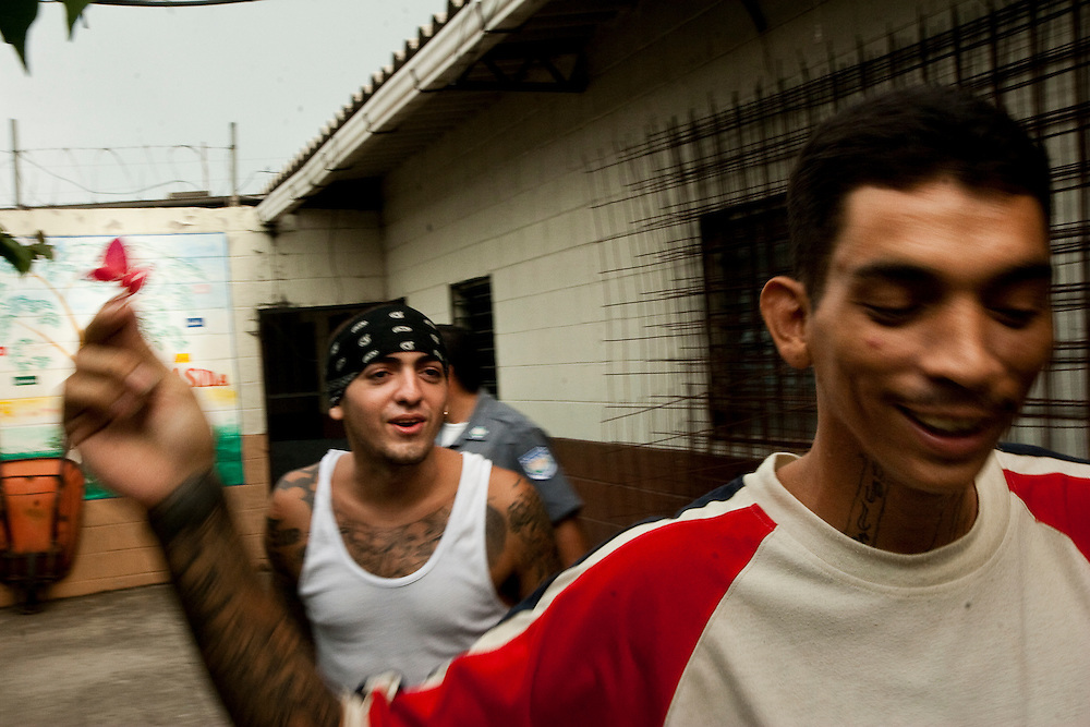 """Anthony Javier Pleiez (left) and Coistian Omar Scopa (right) in the lowest security section of Cojutepecque prison.  Pleiez says his 18th street clique protects his community. """"We are a united gang If we are going to do something we have to come to a conclusion with all the family, because here there is no leaders . Our gang depends on nobody, we are all here because we all care for each other.  We identify with the barrio where we live.  With the other gang (MS-13) , they have problems because the community does not like them.  I don't like the other gangs because they are disturbing the community and robbing and all that shit. We are in charge to look after the people in our barrio."""""""