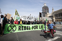 © Licensed to London News Pictures. 15/04/2019. London, UK. Extinction Rebellion blockade Parliament Square as protests take hold throughout London and other UK cities to highlight global climate change. Photo credit: Peter Macdiarmid/LNP