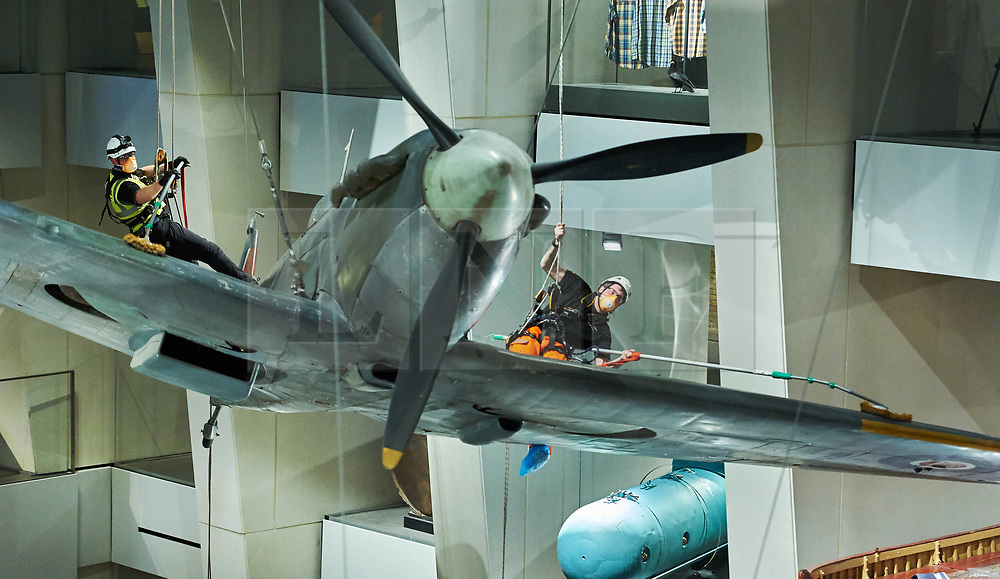 © Licensed to London News Pictures. 01.02.18 London, UK.  A specialist team from Arco Total Access are suspended by ropes to dust a Supermarine Spitfire Mark1A at the Imperial War Museum, London. The rare aircraft is one of few remaining in it's original 1940's paint and is given a clean-up every three years.<br />  Photo credit: Simon Jacobs/LNP