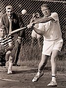 Carter at bat during a softball game at Plains High School. The umpire is consumer advocate and future five-time presidential candidate Ralph Nader. The catcher is James Wooten of the New York Times.