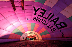 © Licensed to London News Pictures. 09/08/2012. Bristol, UK. One of Bailey's balloons is inflated at the start of the Jones Lang LaSalle Bristol International Balloon Fiesta, which runs from 09-12 August at Ashton Court in Bristol.  This year's fiesta is sponsored by Jones Lang LaSalle. 09 August 2012..Photo credit : Simon Chapman/LNP