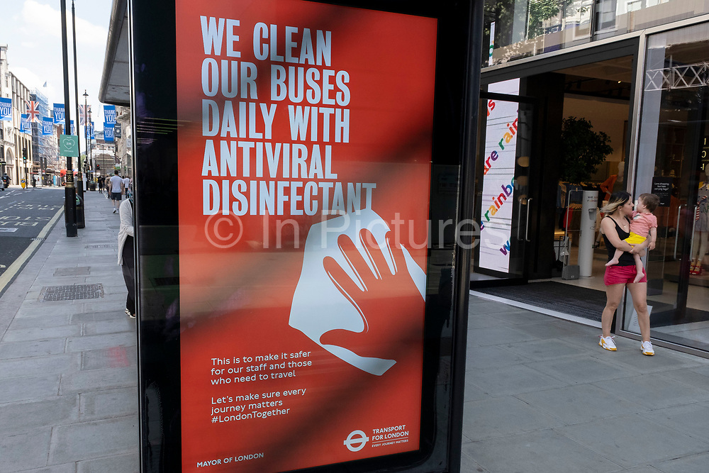 TfL Transport for London advertising boards advise people that precautions are being taken and buses cleaned with antiviral disinfectant each day as some non-essential shops re-open, shoppers return to Oxford Street while social distancing measures are put in place by the various retail shops which are open on 26th June 2020 in London, England, United Kingdom. As the July deadline approaces and government will relax its lockdown rules further, the West End remains quiet, apart from this popular shopping district, which itself has far fewer people on its pavements than normal.