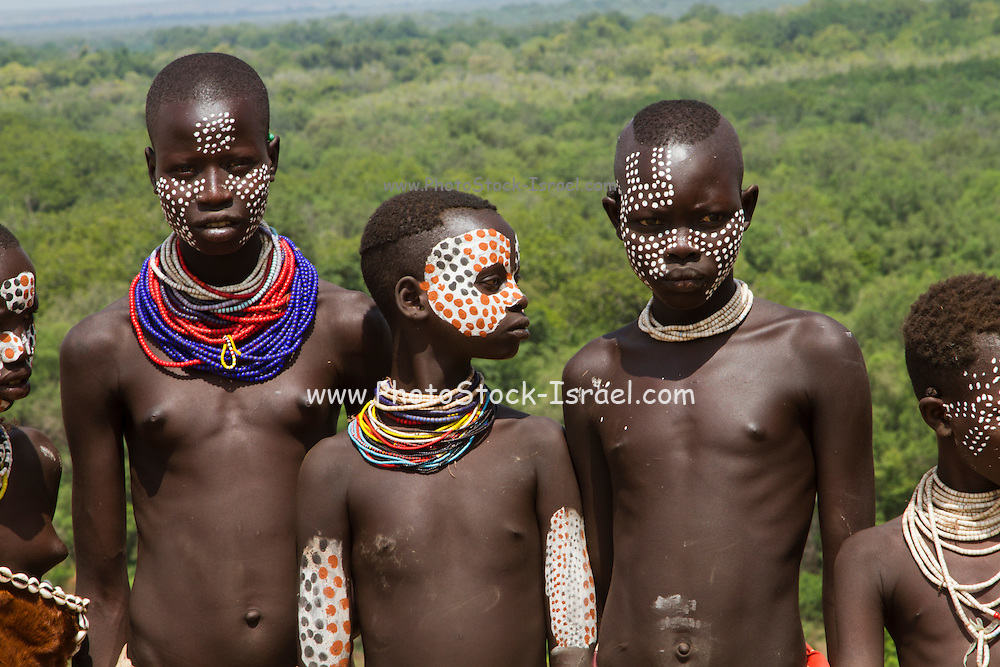 Young topless female teens and children of the Karo tribe. Photographed in the Omo Valley, Ethiopia