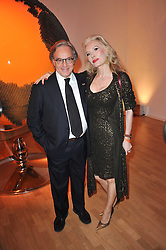 DIEGO DELLA VALLE President and CEO of the Italian leather goods company Tod's and DONATELLA FLICK at the TOD'S Art Plus Drama Party at the Whitechapel Gallery, London on 24th March 2011.