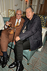 Left to right, SIR DAVID TANG and MARIO TESTINO at a party to celebrate the publication of 'Let's Eat meat' by Tom Parker Bowles held at Fortnum & Mason, Piccadilly, London on 21st October 2014.