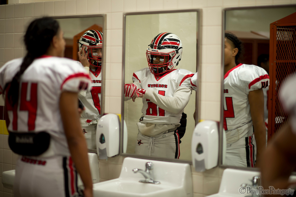 Cordova Lancers Alvin Banks (16), gets ready inside the locker room before the Sac-Joaquin Section Division I football playoff game between the Christian Brothers Falcons and Cordova Lancers at Huges Stadium,  Friday Nov 11, 2016.<br /> photo by Brian Baer