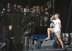 © London News Pictures. 25/08/2012. Reading, UK. Lead singer Rou Reynolds performing with Enter Shikari on the main stage on day two of Reading Festival 2012 in Reading, Berkshire, UK on August 25, 2012. The three day event which attracts over 80,000 music fans headlines The Cure, Kasabian and The Foo Fighters Photo credit : Ben Cawthra/LNP