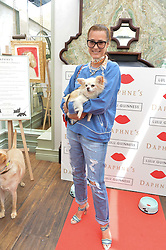 YASMIN LE BON and her dog Tinka at a party hosted by Lulu Guinness and Daphne's to launch Lulu's Designer Dog Bowl and to mark Daphne's allowing dogs through it's doors, held at Daphne's, Draycott Avenue, London on 28th June 2016.