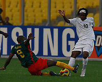 Photo: Steve Bond/Richard Lane Photography.<br /> Cameroun v Zambia. Africa Cup of Nations. 26/01/2008. Njitap Geremi (L) gets a tackle in on Ian Bakala (R)