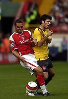 Photo: Olly Greenwood.<br />Charlton Athletic v Arsenal. The Barclays Premiership. 30/09/2006. Charlton's Luke Young tackles Arsenal's Cesc Fabregas