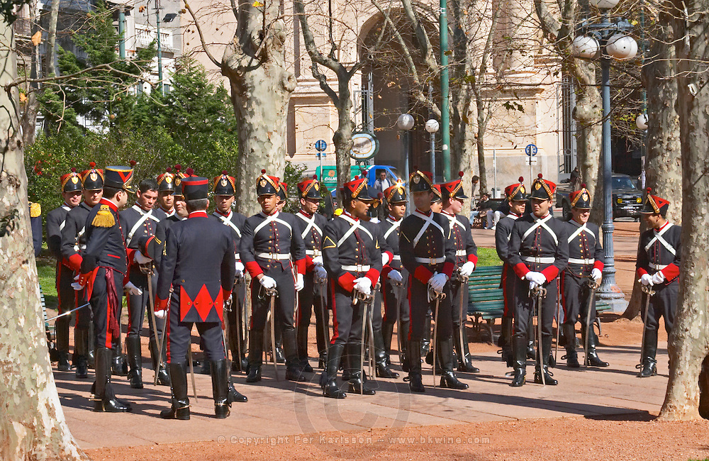 A military parade on the Plaza Constitucion Constitution Square dressed in old style uniforms and carrying sabres. Montevideo, Uruguay, South America