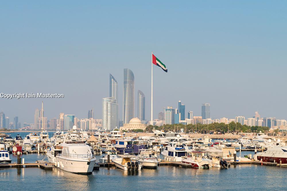 Yacht marina and skyline of modern skyscrapers on waterfront in Abu Dhabi United Arab Emirates UAE