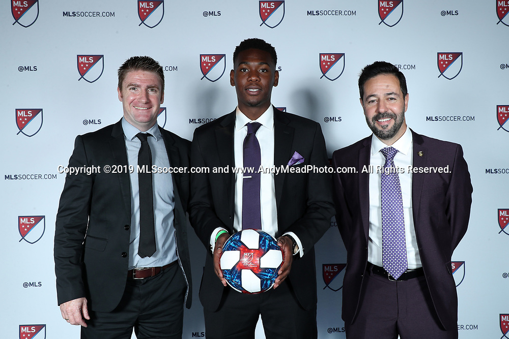 CHICAGO, IL - JANUARY 11: Kamal Miller was taken with the 27th overall pick by Orlando City SC. With head coach James O'Connor (left) and executive vice president of soccer operations Luiz Muzzi (right). The MLS SuperDraft 2019 presented by adidas was held on January 11, 2019 at McCormick Place in Chicago, IL.