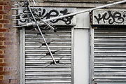 A landscape of a broken and twisted TV aerial and the metal shutters of a business opposite St. Mar Cray station, on 3rd February 2020, in London, England