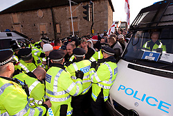 © under license to London News Pictures. 11/12/2010. Continuing their protests in towns and cities across the UK, the English Defence League protest against militant Islam in Peterborough. As they arrive, EDL protesters clash with police as they try to get to a counter-protest by Unite Against Fascism