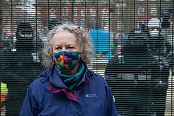 London, UK. 31 January, 2021. Jenny Jones, Baroness Jones of Moulsecoomb, waits to speak to Karl Harrison from the National Eviction Team (NET) at Euston Square Gardens. The NET are currently dismantling a camp there built by HS2 Rebellion activists seeking to protect trees from felling by HS2 Ltd in connection with the controversial HS2 high-speed rail project. Five activists continue to occupy tunnels beneath the camp, including Dan Hooper who was known as the roads protester Swampy during the 1990s.